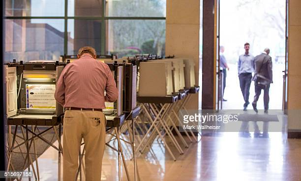 Voters cast their ballots in the presidential primary at the Leon County Courthouse on March 15 2016 in Tallahassee Florida Voters cast ballots in...