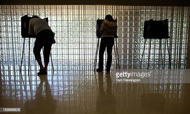 Voters cast their ballots on November 6 2012 in Mansfield Texas Americans across the country participate in Election Day as President Barack Obama...