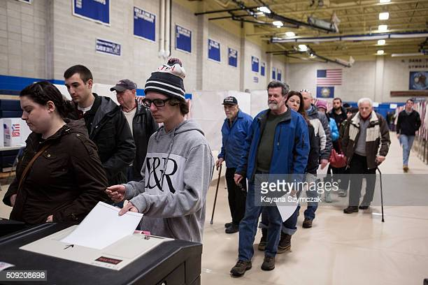 Voters cast their votes at Merrimack High School on primary day February 9 in Merrimack New Hampshire Tuesday is the 100th anniversary of the New...