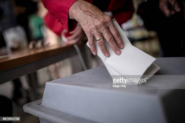 Voters casts her ballot in state elections in North RhineWestphalia on May 14 2017 in Muehlheim an der Ruhr Germany The election today the third...