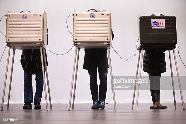 Voters casts their ballots at ChiArts High School on March 15 2016 in Chicago Illinois Voters in Illinois Missouri North Carolina Florida and Ohio...