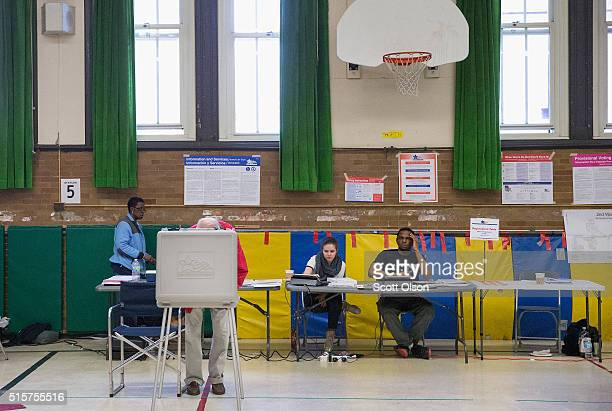 Voters casts their ballots at Columbus Elementary School on March 15 2016 in Chicago Illinois Voters in Illinois Missouri North Carolina Florida and...