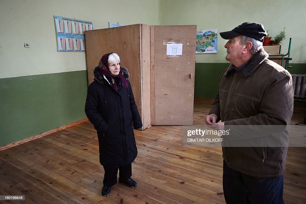 Voters chat at a polling station during the national referendum in the town of Belene on January 27, 2013. Bulgarians voted Sunday on whether to revive plans ditched by the government to construct a second nuclear power plant, in the EU member's first referendum since communism. The referendum asks 6.9 million eligible voters: 'Should Bulgaria develop nuclear energy by constructing a new nuclear power plant?'
