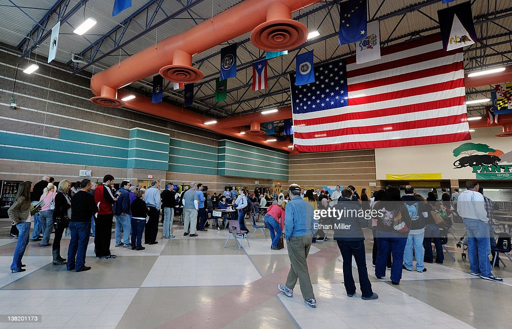 Voters check in as they arrive to caucus for the Republican presidential candidate at Palo Verde High School February 4, 2012 in Las Vegas, Nevada. Nevada is the first state in the West to vote as Republicans go about choosing their presidential candidate.