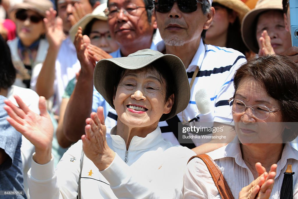 Voters cheer as they listen to a speech by Japanese Prime Minister and president of the Liberal Democratic Party (LDP) Shinzo Abe during the ruling coalition junior partner New Komeito Party (NKP) election campaign for the upper house election on June 27, 2016 in Kobe, Japan. Japanese Prime Minister Shinzo Abe joined the campaign to show support for a candidate from Komeito for the first time. The Komeito is a coalition partner of his Liberal Democratic Party.