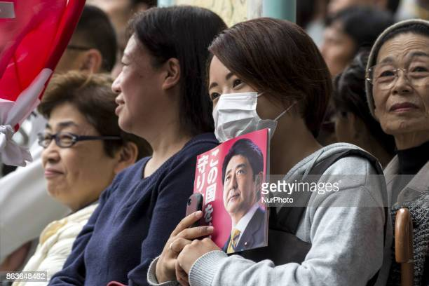 Voters cheer Japanese Prime Minister Shinzo Abe delivering a campaign speech for a candidate of Abe's ruling Liberal Democratic Party during the...