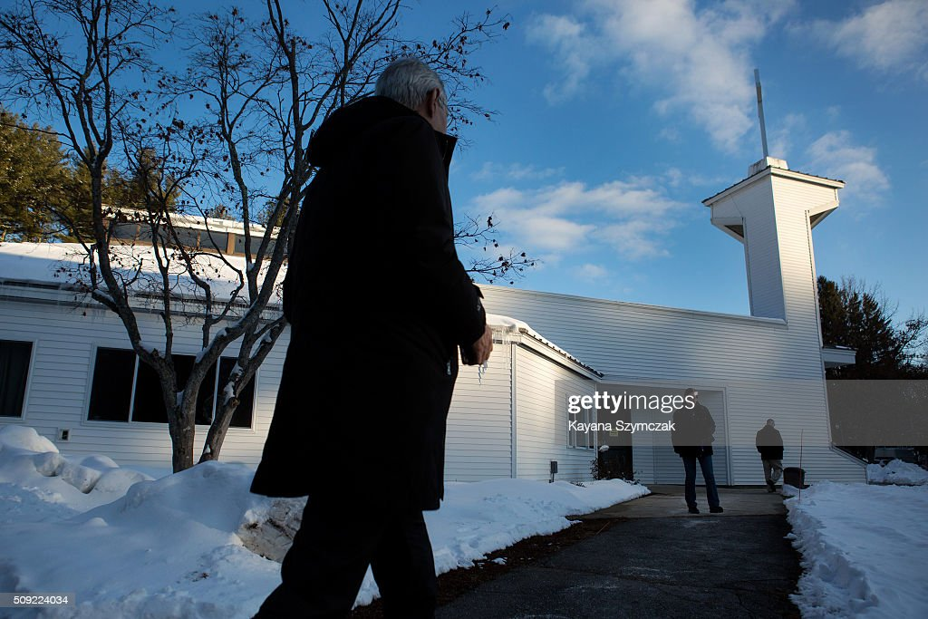 Voters enter and exit the polling location at First Baptist Church on primary day, February 9, 2016, in Nashua, New Hampshire. Tuesday is the 100th anniversary of the New Hampshire primary, the 'First in the Nation' test for presidential candidates from both parties.