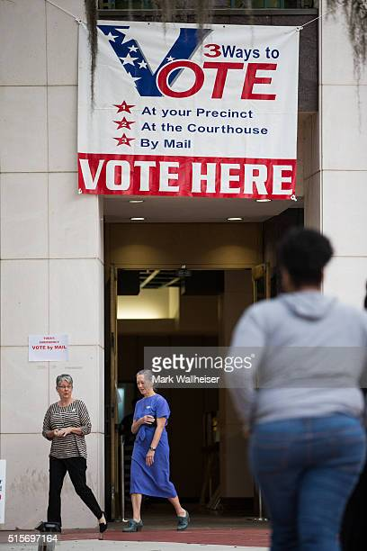 Voters enter and exit their precinct to cast their ballots in the presidential primary at the Leon County Courthouse on March 15 2016 in Tallahassee...