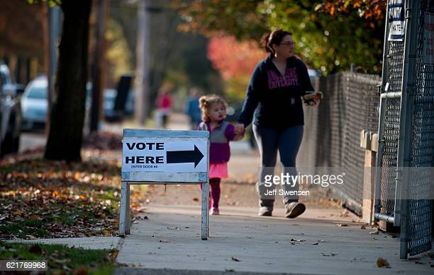 Voters enter the polls to vote in the presidential election on November 8 2016 in Oakmont Pennsylvania Americans across the nation make their choice...