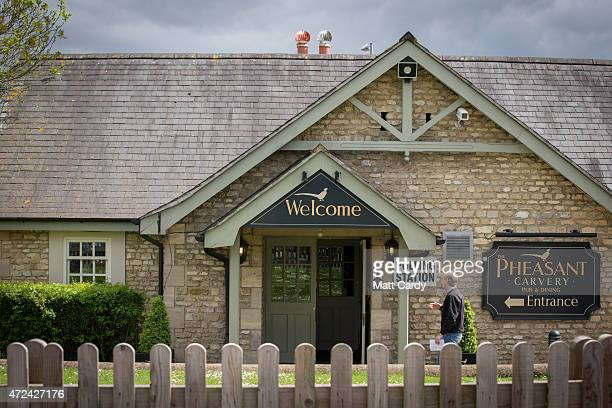 A voters enters a polling station located in the Pheasant Carvery in Chippenham on May 7 2015 in Wiltshire England The United Kingdom has gone to the...