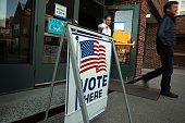 Voters exit a polling station on November 4 2014 in Westport Connecticut Around the country voters are turning out to decide the 2014 midterm...