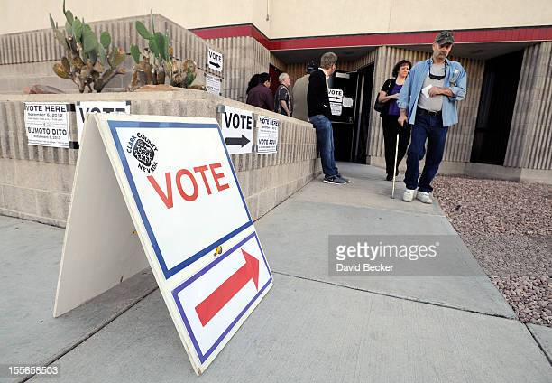 Voters exit the polling station at the Clark County Fire Training Center after casting their ballots on November 6 2012 in Las Vegas Nevada Voting is...