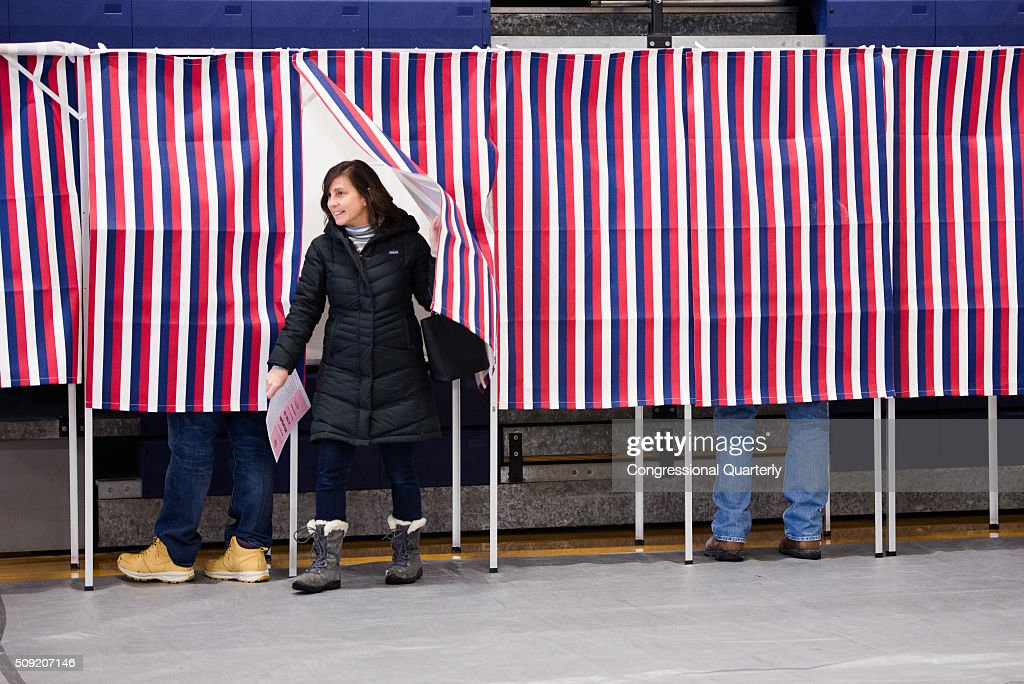 Voters fill out their ballots for the 2016 New Hampshire primary in voting booths at Londonderry High School in Londonderry, NH on February 9, 2016.