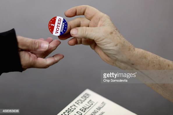 Voters get an 'I VOTED TODAY' sticker after casting their ballots on election day at the Red Oak Fire Department November 4 2014 in Red Oak Iowa...