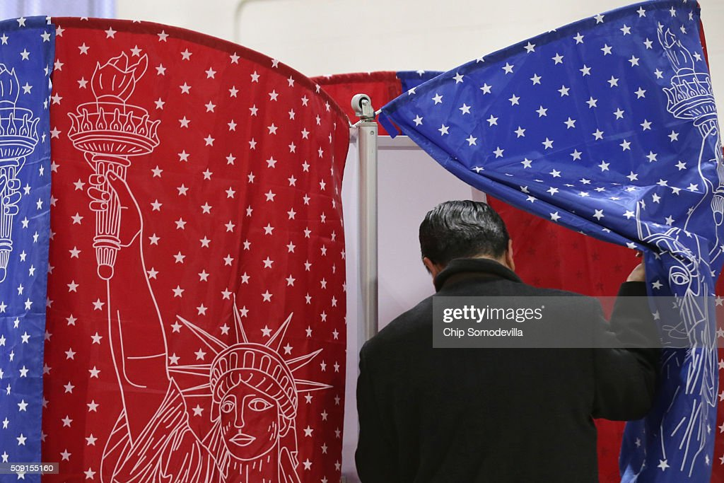 Voters head to the polling booths inside the Webster School gymnasium February 9, 2016 in Manchester, New Hampshire. Tuesday is the 100th anniversary of the New Hampshire primariy, the 'First in the Nation' test for presidential candidates from both parties.
