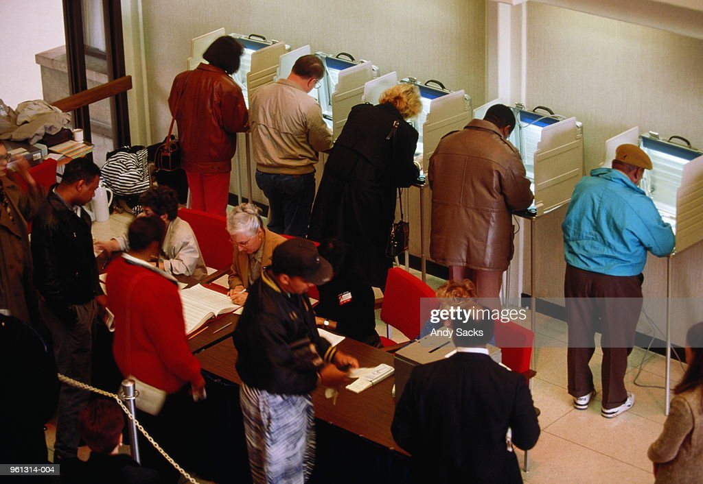 Voters in booths at election, elevated view : Stock Photo