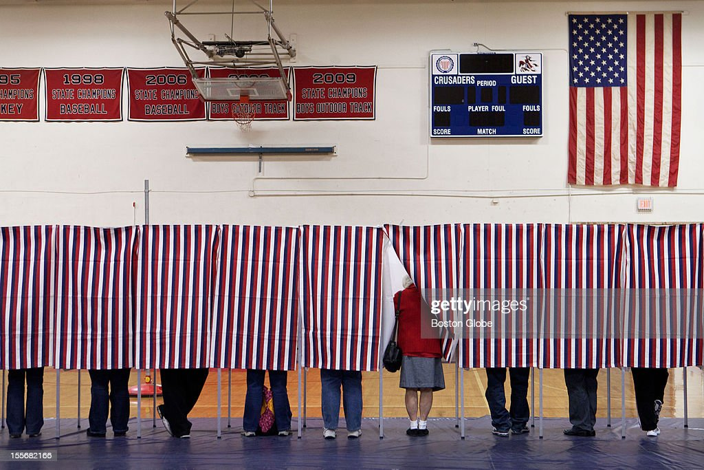 Voters in Manchester, New Hampshire fill out ballots at Memorial High School on Election Day, November 6, 2012.