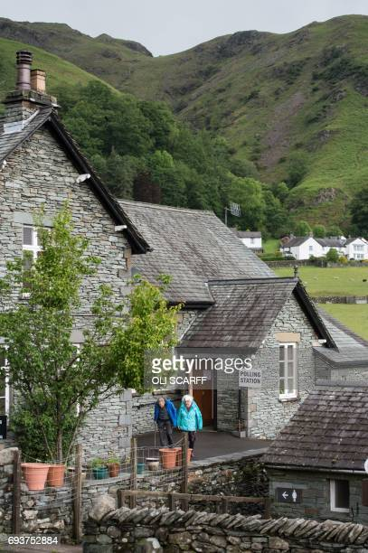 Voters leave a polling station after voting in Chapel Stile Ambleside northwest England on June 8 as Britain holds a general election As polling...