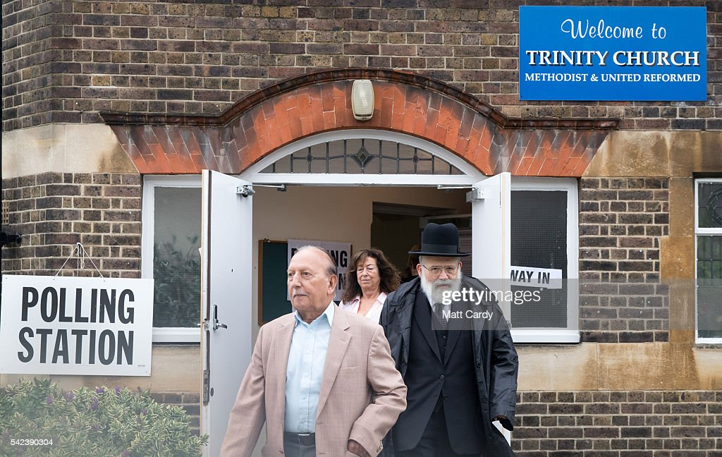 Voters leave a polling station at Trinity Church in Golders Green on June 23 2016 in London England The United Kingdom has gone to the polls to...