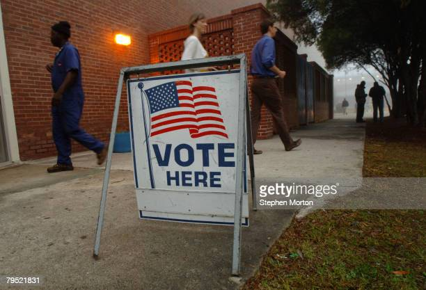Voters leave a precinct after casting their ballots during Georgia's primary Super Tuesday's presidential election January 5 2008 in Savannah Georgia...