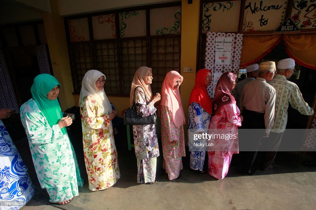 Voters line up at a polling station during election day on May 5, 2013 in Pekan, Malaysia. Millions of Malaysians casted their vote on Sunday in one of the most tightly contested Malaysian election since independence in 1957. The opposition coalition, Pakatan Rakyat (PeopleÕs Alliance), led by former deputy prime minister Anwar Ibrahim is seeking to gain power on a national level against the ruling party Barisan Nasional.