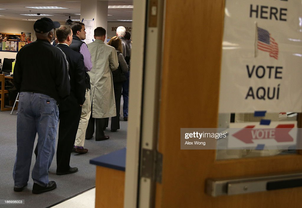 Voters line up at a polling station to cast their votes on Election Day November 5 2013 at Spring Hill Elementary School in McLean Virginia...