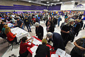 Voters line up for a Republican caucus at Durango High School on February 23 2016 in Las Vegas Nevada Nevada voters are caucusing to choose a...