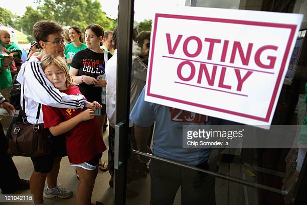 Voters line up outside the Hilton Coliseum to vote in the Iowa Straw Poll at Iowa State University August 13 2011 in Ames Iowa Nine GOP presidential...