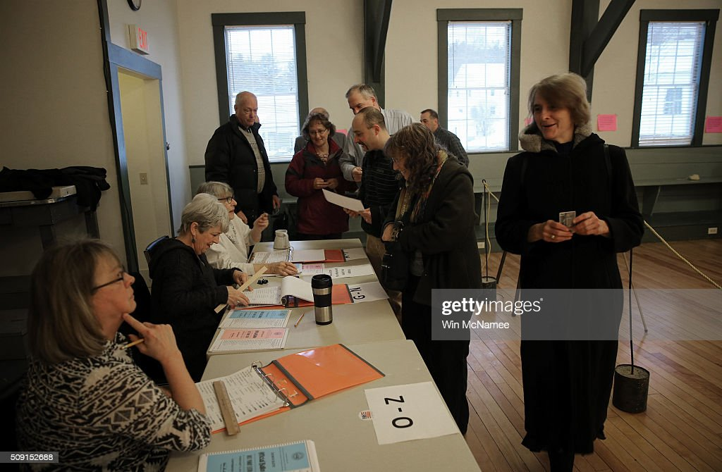 Voters line up to cast their ballots at 7:00AM as the Canterbury Town Hall polling station opens February 9, 2016 in Canterbury, New Hampshire. Voters throughout the state are heading to the polls as the New Hampshire Primary, also known as the first-in-the-nation primary, continues the process of selecting the next president of the United States.