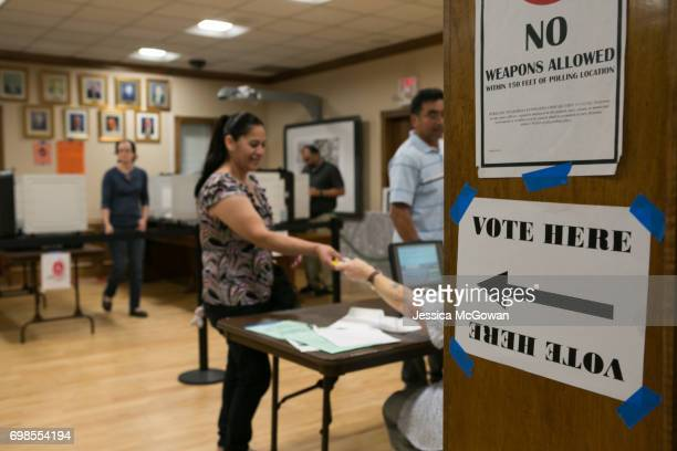Voters line up to cast their vote in the 6th Congressional District runoff election between Republican Karen Handel and Democrat Jon Ossoff at the...