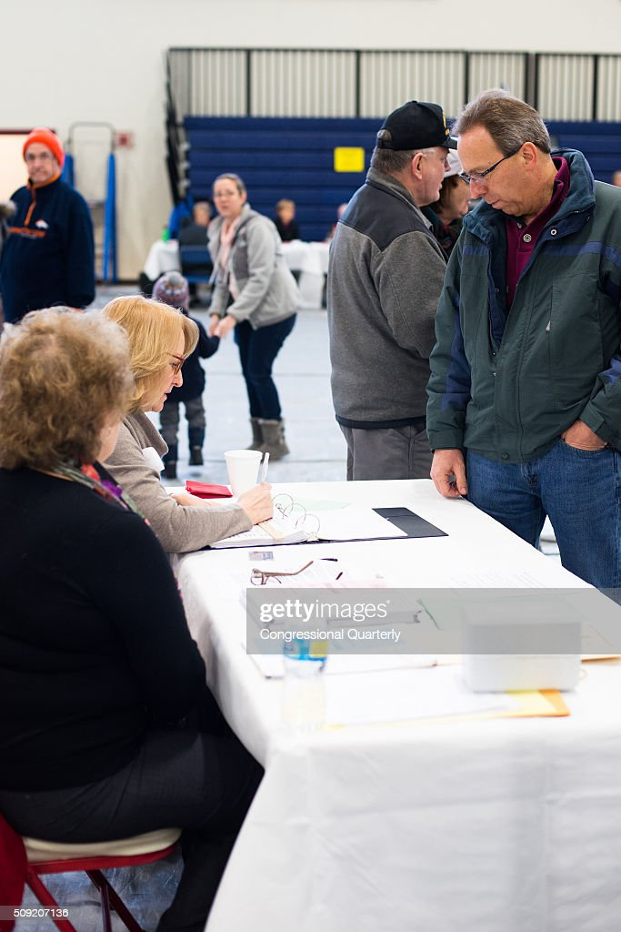 Voters line up to get their ballots to vote at the Londonderry High School in the 2016 New Hampshire primaries in Londonderry, NH on February 9, 2016.