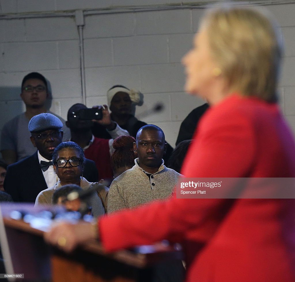 Voters listen as Democratic presidential candidate <a gi-track='captionPersonalityLinkClicked' href=/galleries/search?phrase=Hillary+Clinton&family=editorial&specificpeople=76480 ng-click='$event.stopPropagation()'>Hillary Clinton</a> speaks in South Carolina a day after her debate with rival candidate Bernie Sanders on February 12, 2016 in Denmark, South Carolina. Clinton is counting on strong support from the African American community in South Carolina to give her a win over Sanders in the upcoming primary on February 27.
