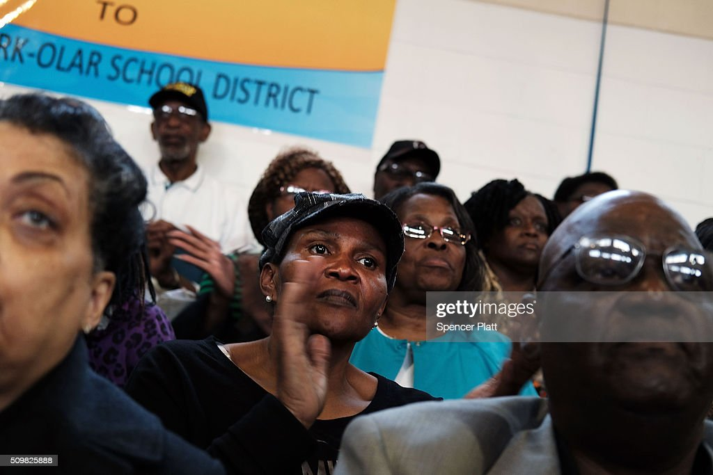 Voters listen to Democratic presidential candidate Hillary Clinton speak in South Carolina a day after her debate with rival candidate Bernie Sanders on February 12, 2016 in Denmark, South Carolina. Clinton is counting on strong support from the African American community in South Carolina to give her a win over Sanders in the upcoming primary on February 27.