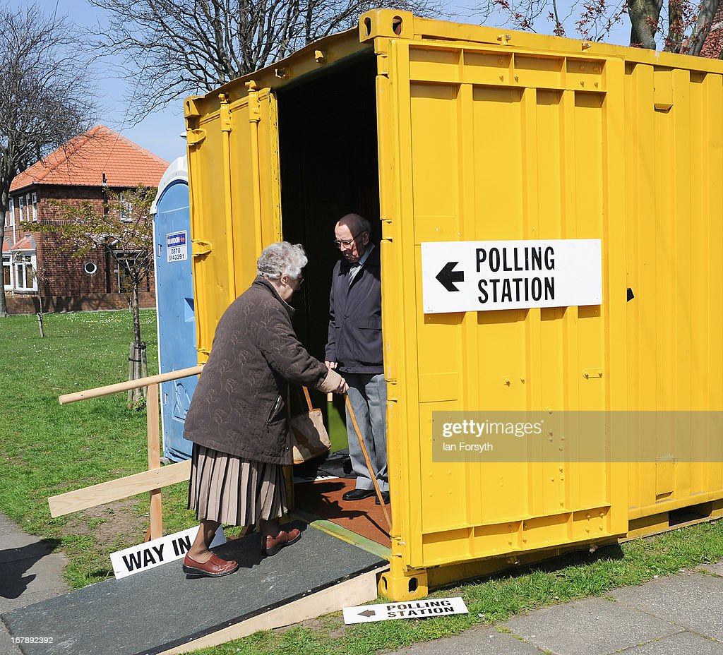 Voters make their way into a portable polling station on May 2, 2013 in South Shields, England. The byelection was triggered after the former foreign secretary David Miliband announced recently that he was resigning from the House of Commons in order to leave Britain and head up the New York based International Rescue Committee humanitarian organisation.