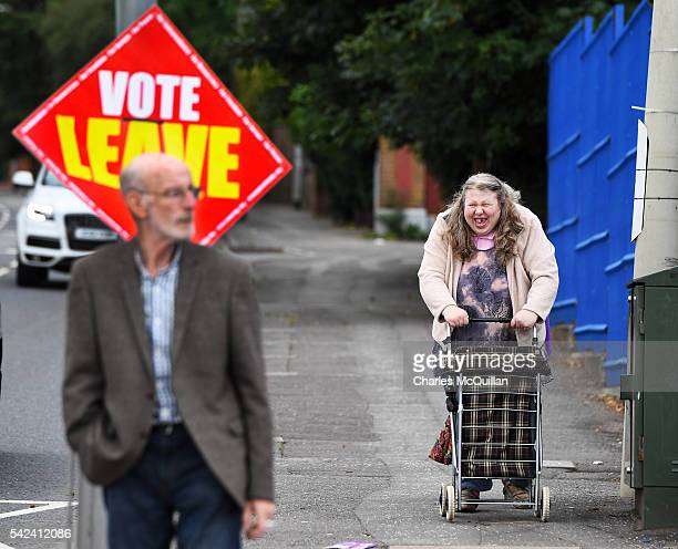 Voters make their way towards a polling station to vote in the EU referendum on June 23 2016 in Belfast Northern Ireland The United Kingdom has gone...