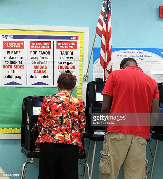 Voters mark their ballots in polling place featuring instructions in English Spanish and Creole November 2 2010 in Miami Florida Voters are deciding...