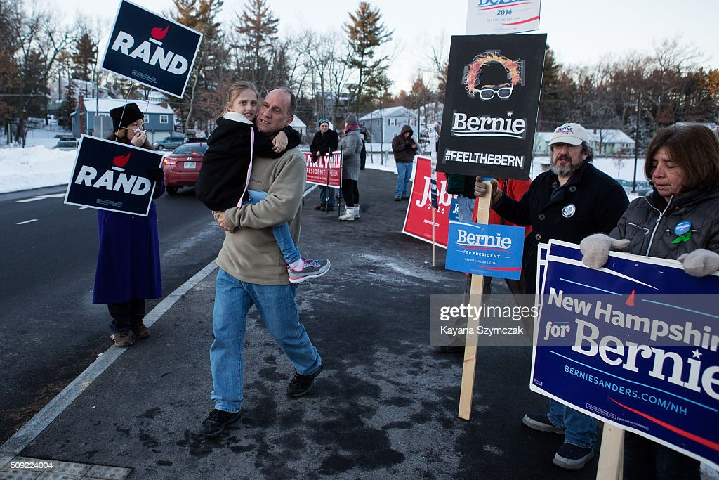 Voters pass by people campaigning for candidates as they make their way to the polls at Broad Street Elementary School on primary day, February 9, 2016, in Nashua, New Hampshire. Tuesday is the 100th anniversary of the New Hampshire primary, the 'First in the Nation' test for presidential candidates from both parties.