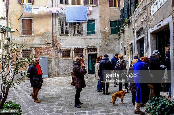 Voters que in front of a Democratic Party polling station during today primary elections on December 8 2013 in Venice Italy Italians are voting today...
