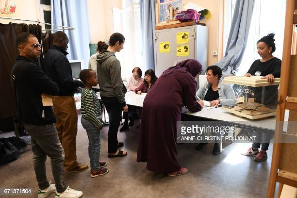 Voters queue at a polling station in Marseille southern France on April 23 2017 during the first round of the French presidential election / AFP...
