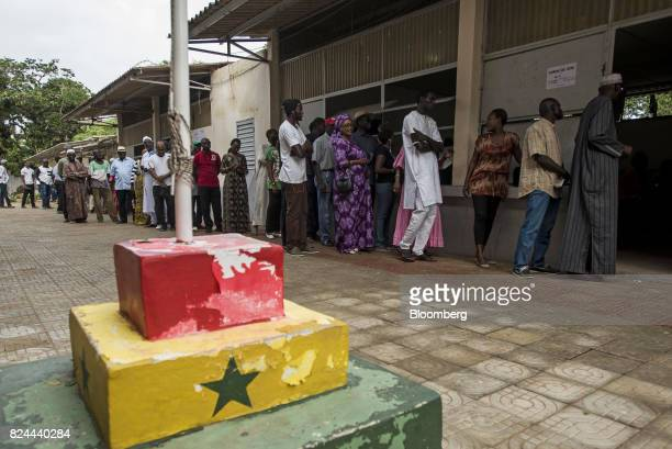 Voters queue outside a polling station during parliamentary elections in Dakar Senegal on Sunday July 30 2017 Senegalese voters are choosing a new...