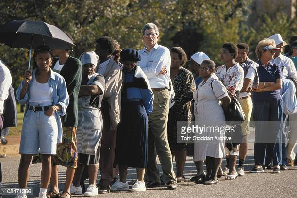 Voters queue outside a polling station during South Africa's first General Election to be held with universal adult suffrage 27th April 1994
