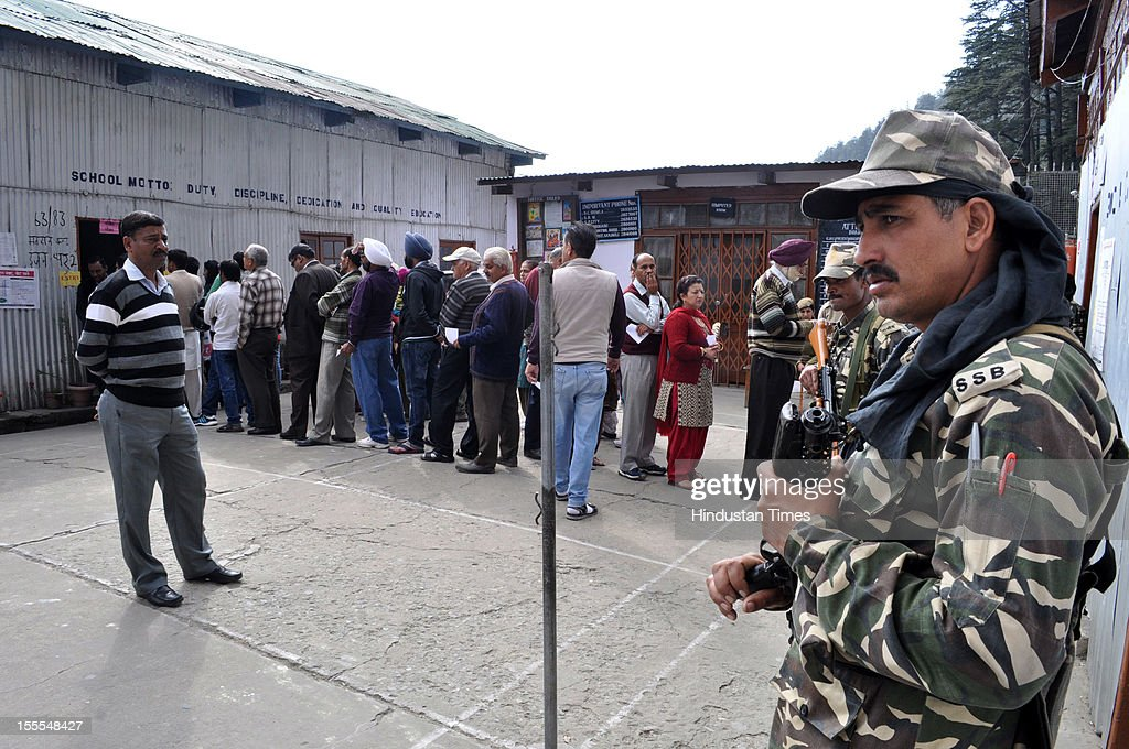 Voters queue outside a polling station for the Himachal Assembly electionat Tara Hall in Shimla, on November 04, 2012 in Himachal Pardesh, India. Voting figures have indicated a high percentage turnout for polling in the assembly election.
