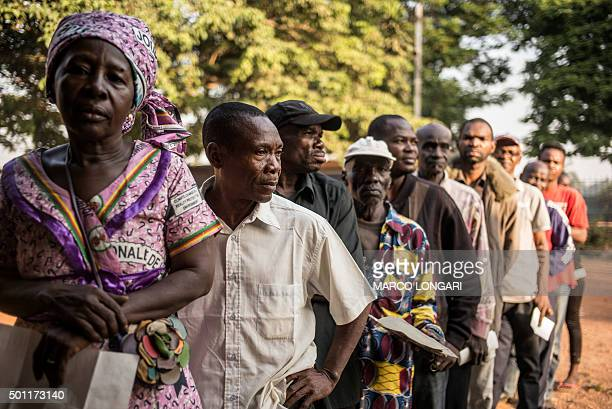 Voters queue outside a polling station in Bangui on December 13 2015 to vote for the constitutional referendum seen as a test run for presidential...