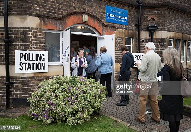 Voters queue to enter a polling station at Trinity Church in Golders Green on June 23 2016 in London England The United Kingdom has gone to the polls...