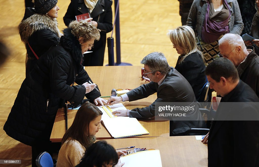 Voters queue to place their ballots during the national election in Monaco on February 10, 2013 AFP PHOTO / VALERY HACHE