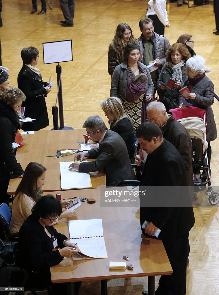 Voters queue to place their ballots during the national election in Monaco on February 10, 2013