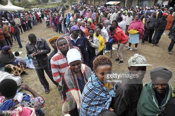 Voters queue to vote outside a polling station at the Don Bosco center in Kiserian Kenya on Tuesday Aug 8 2017 The politicians are vying to lead a...