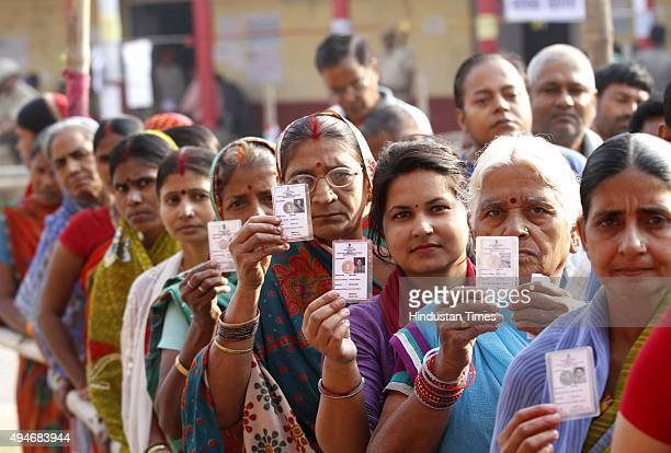 Voters queue up to cast their vote at DAV School polling booth for 3rd Phase of Bihar Assembly Election on October 28 2015 at Danapur constituency...