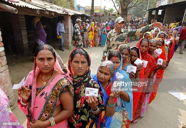 Voters queue up to cast their vote for 3rd Phase of Bihar Assembly Election at Rajkiya Madhya Vidyalaya at Dawoodpur on October 28 2015 in Danapur...