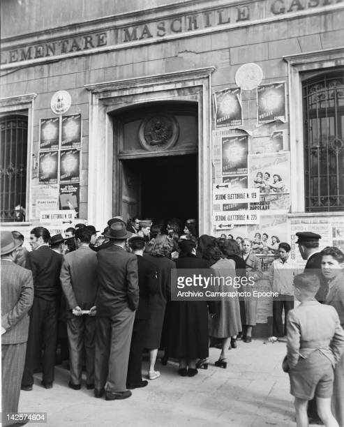 Voters queuing at a polling station in an elementary school in Italy during the general election 18th April 1948
